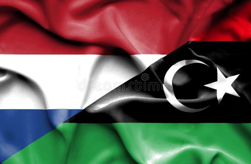 利比亚和荷兰的挥动的旗子 库存例证
