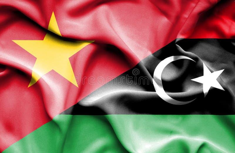 利比亚和越南的挥动的旗子 皇族释放例证