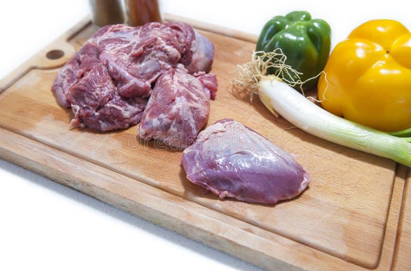 利比亚猪肉面颊片断与菜的 库存图片