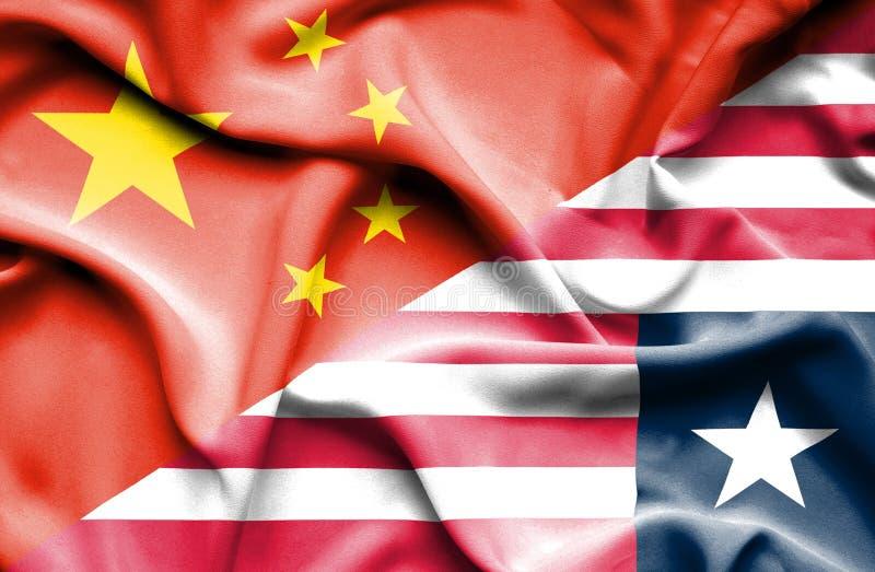 利比里亚和中国的挥动的旗子 向量例证