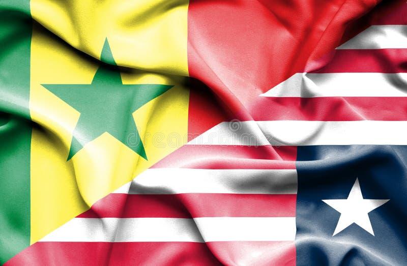 利比里亚和塞内加尔的挥动的旗子 皇族释放例证