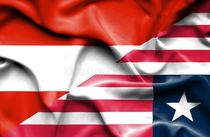利比里亚和奥地利的挥动的旗子 库存例证