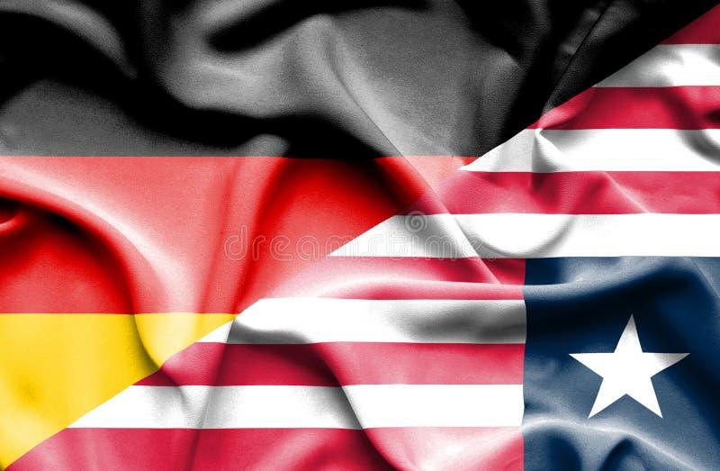 利比里亚和德国的挥动的旗子 皇族释放例证