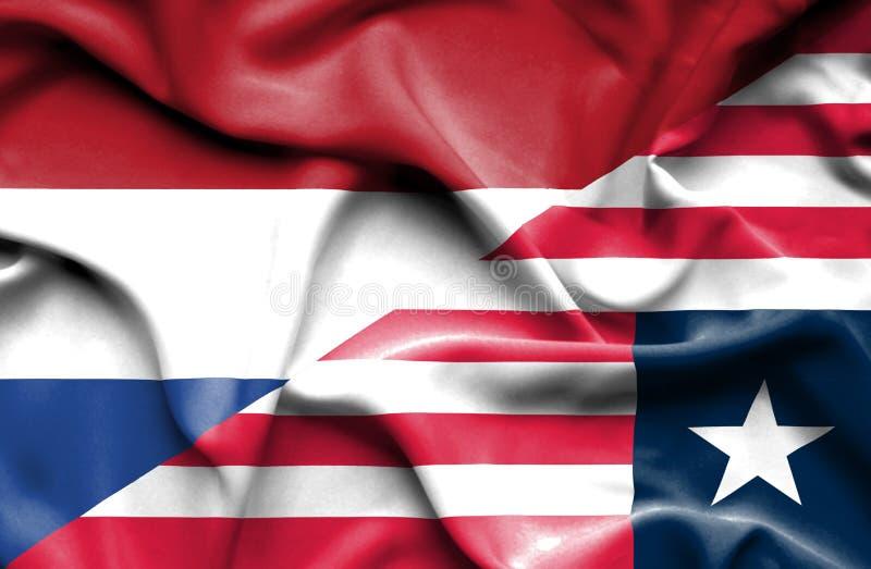 利比里亚和荷兰的挥动的旗子 向量例证