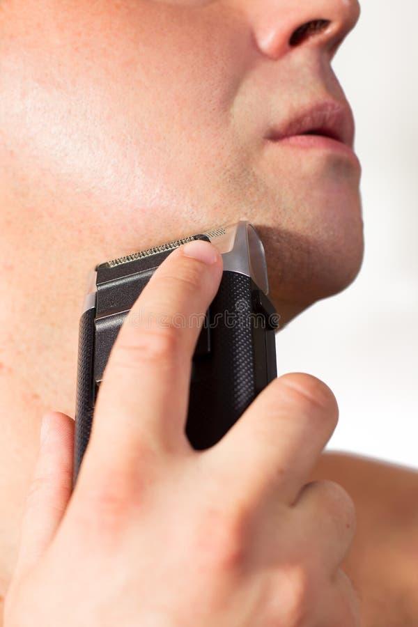 刮与电动剃须刀 免版税图库摄影