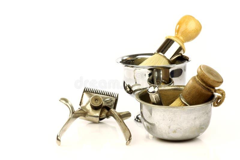 刮工具葡萄酒的理发师 库存照片