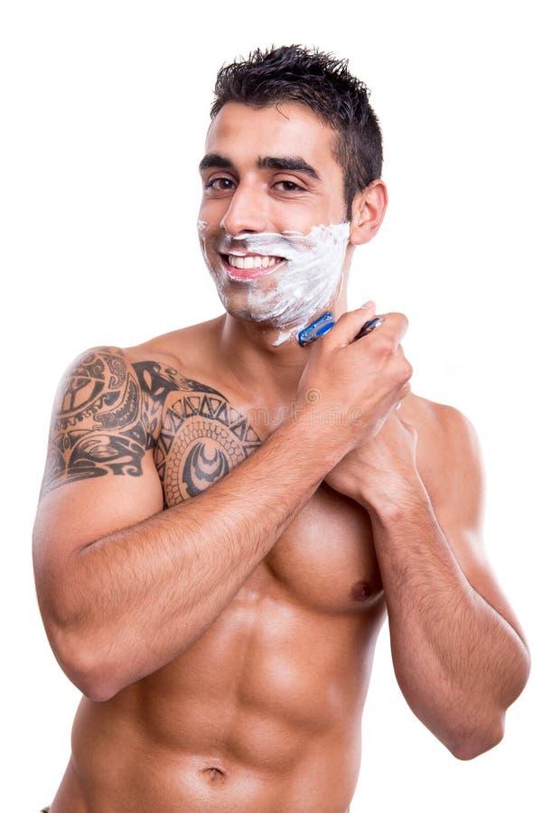 刮他的面孔的人 图库摄影