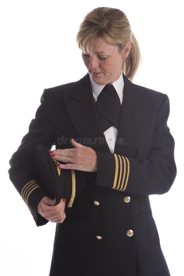 制服的女性飞行员 免版税图库摄影