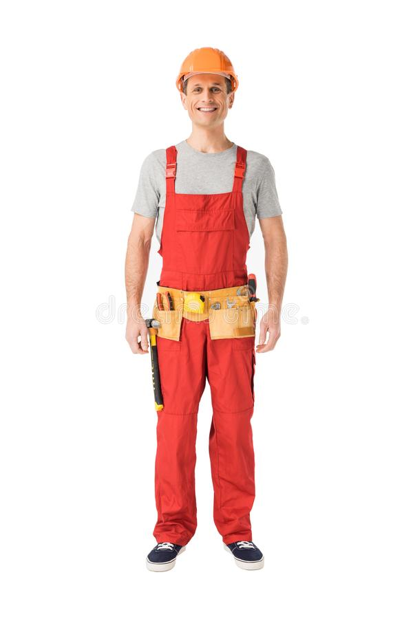制服的快乐的建筑工人 免版税库存照片