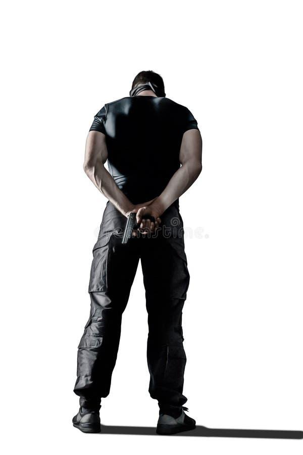 黑制服的站立与枪的人和面具被隔绝 库存照片