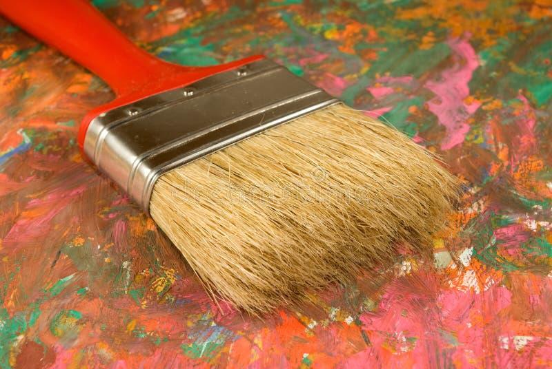 刷子和帆布与油漆 免版税库存图片