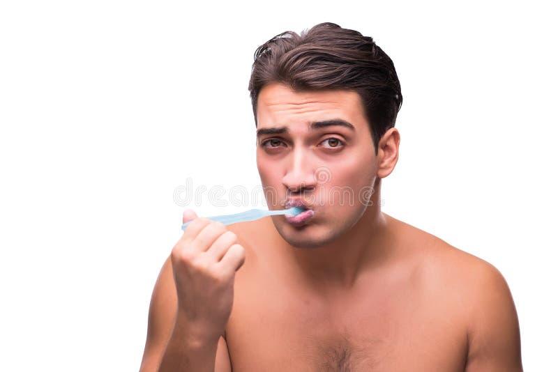 刷他的牙的英俊的人隔绝在白色 库存照片