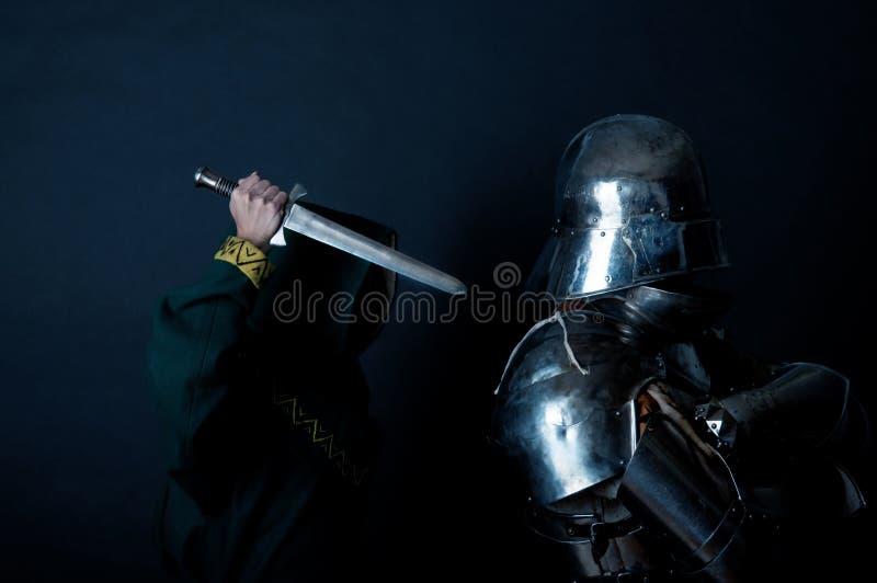刺客荣耀尝试的杀害骑士 库存图片