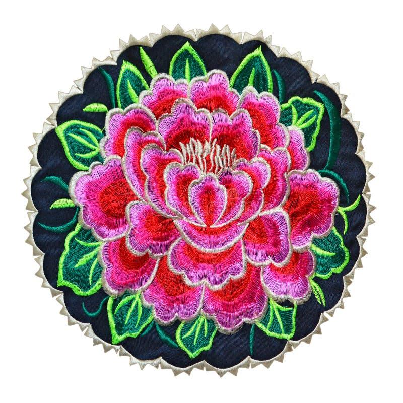 刺绣玫瑰色徽章保险开关 免版税库存照片