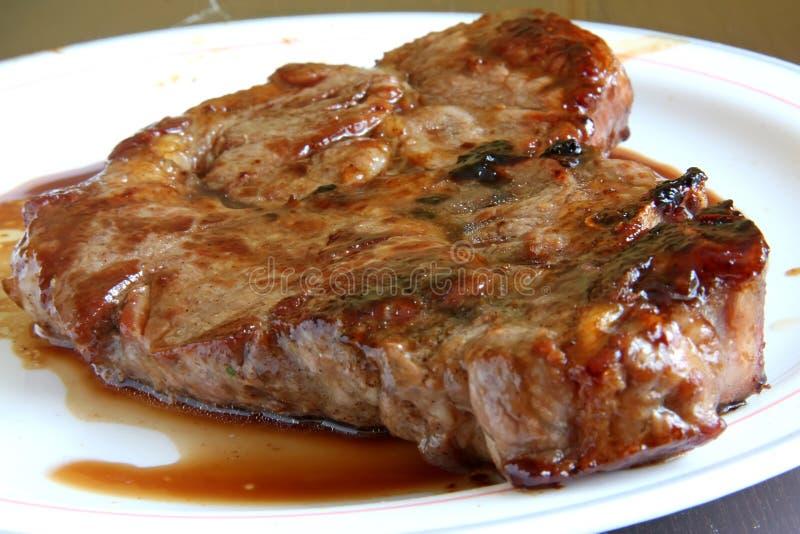 剁猪肉 免版税库存照片