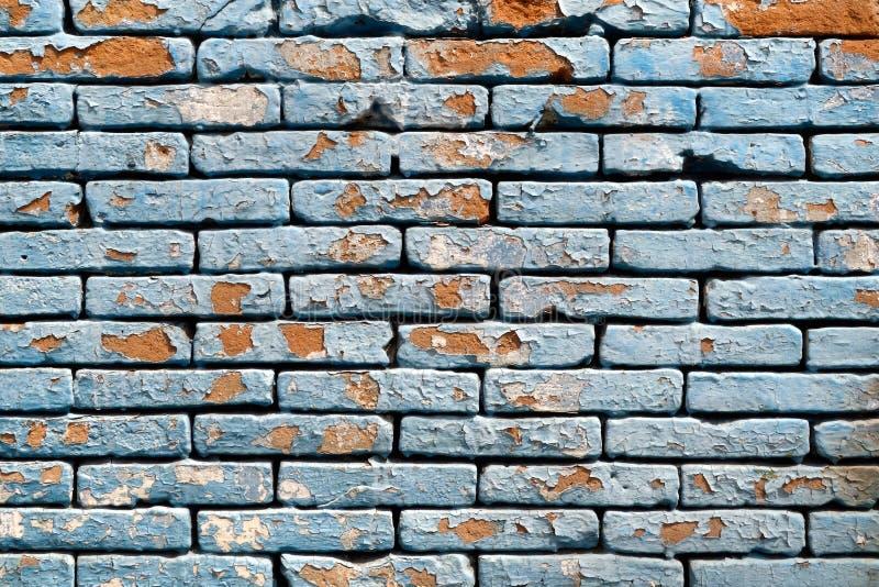 削皮油漆砖墙背景纹理 免版税库存照片