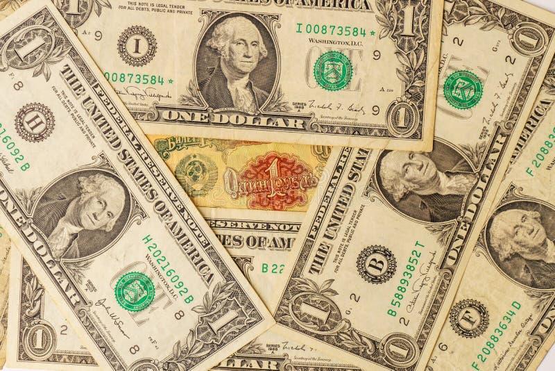 前苏联的老钞票有美国人的一美金 1卢布苏联和许多美国一美金 库存图片