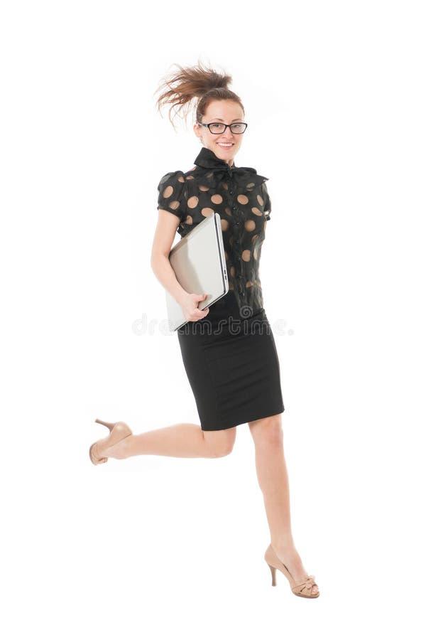 前面一步 ?? 富启示性的创新 企业夫人启发了强有力的感觉 女孩被启发的举行膝上型计算机跃迁 免版税库存照片