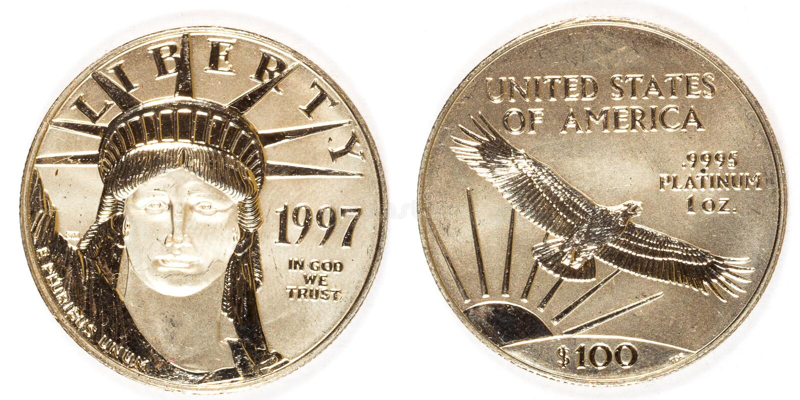 前面和后面白金一百美元硬币 图库摄影
