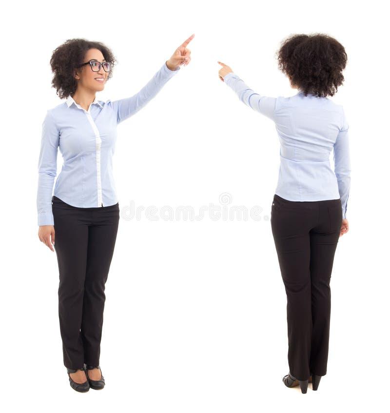 前面和后面看法非裔美国人女商人指向 库存照片