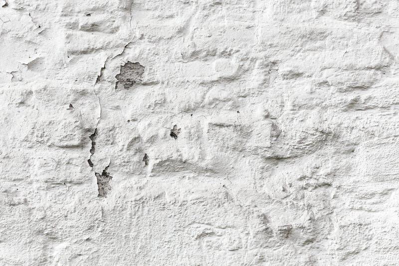 剥白色砖墙难看的东西纹理 免版税库存图片