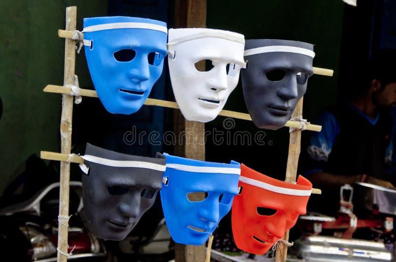 剧院概念五颜六色的塑料面具 库存图片