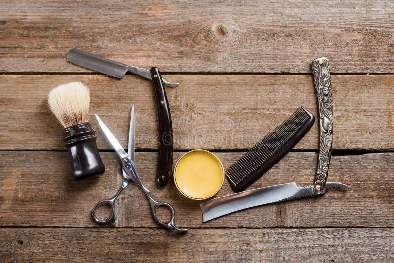 剪刀、蜡和梳子 库存图片