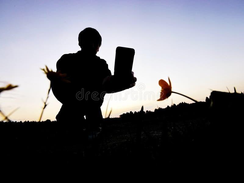 剪影人拍摄 免版税库存照片