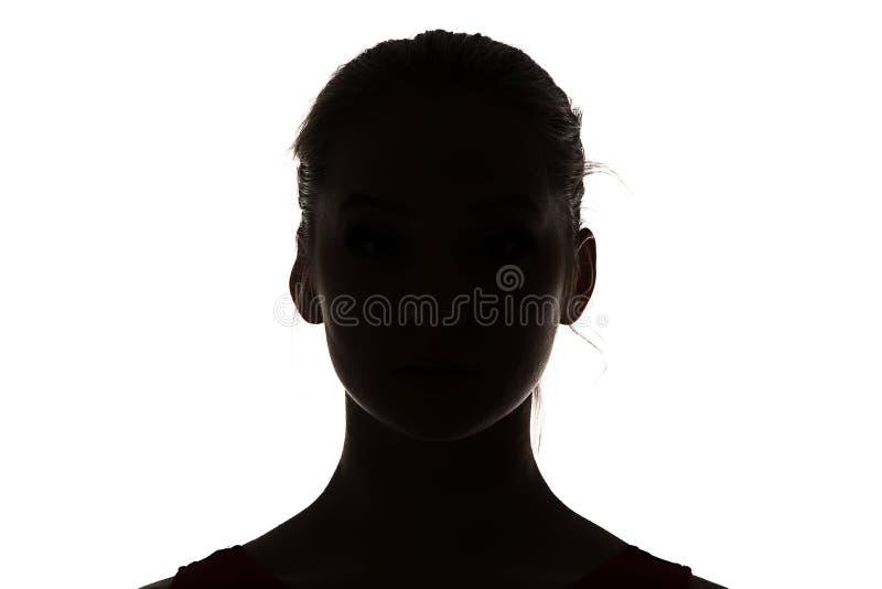 剪影十几岁的女孩的图象 免版税库存照片