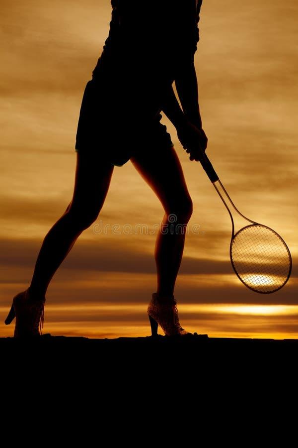 剪影妇女腿网球前面 库存照片