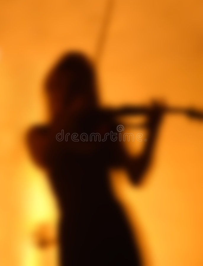 剪影小提琴手 图库摄影