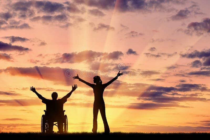剪影愉快的残疾人和监护人 库存图片