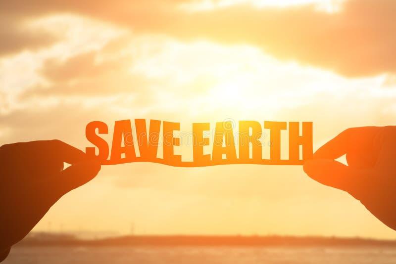 剪影救球地球词 库存例证