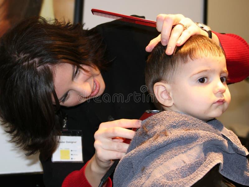 剪第一根头发 库存图片