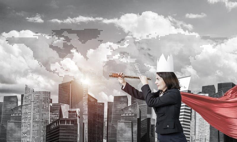 力量和成功的概念与女实业家超级英雄大的 库存图片