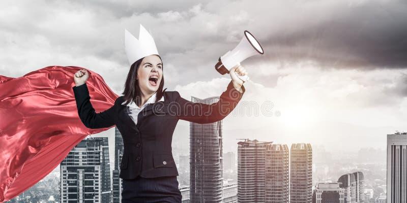 力量和成功的概念与女实业家超级英雄大的 免版税库存照片