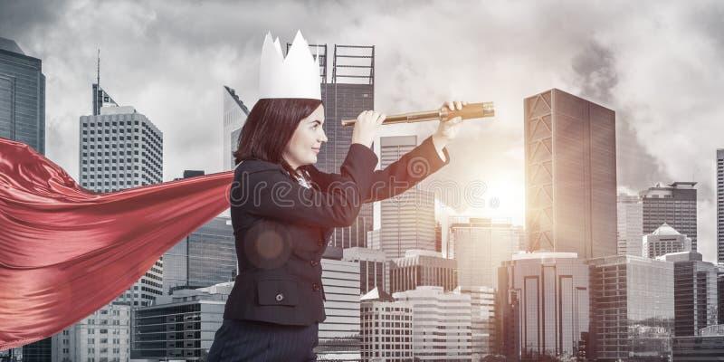 力量和成功的概念与女实业家超级英雄大的 免版税图库摄影