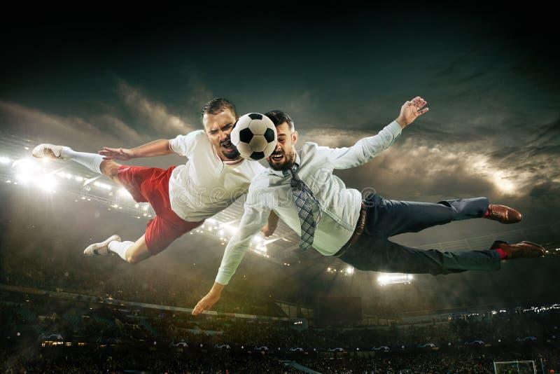办公室体育场的人作为足球或足球选手 免版税库存照片