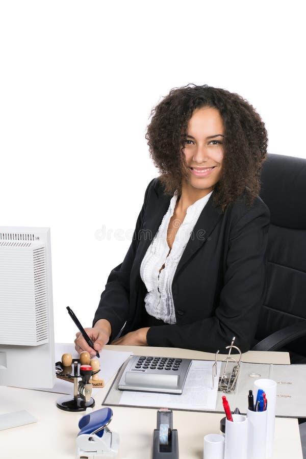 年轻办公室工作者写道 免版税库存照片