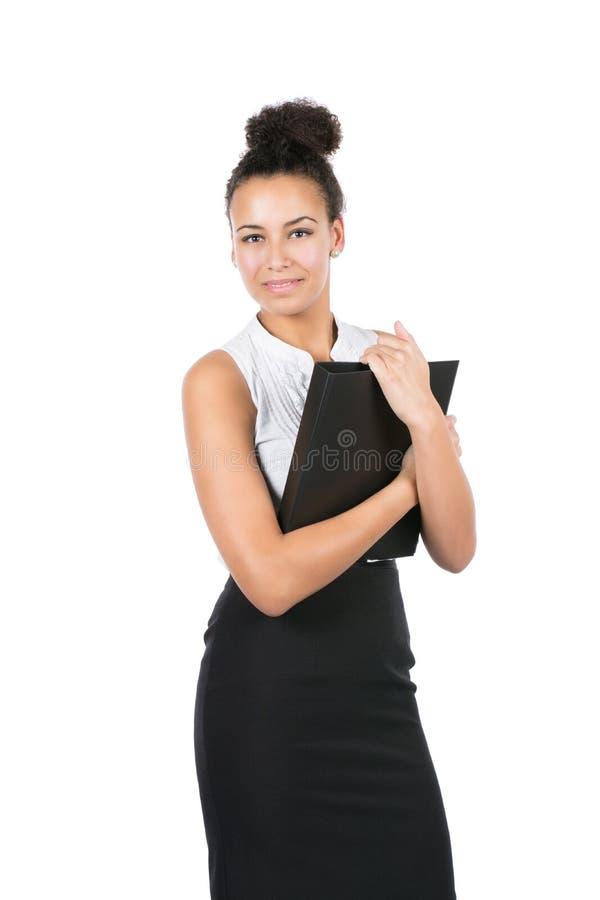 年轻办公室工作者拿着一个文件 免版税图库摄影