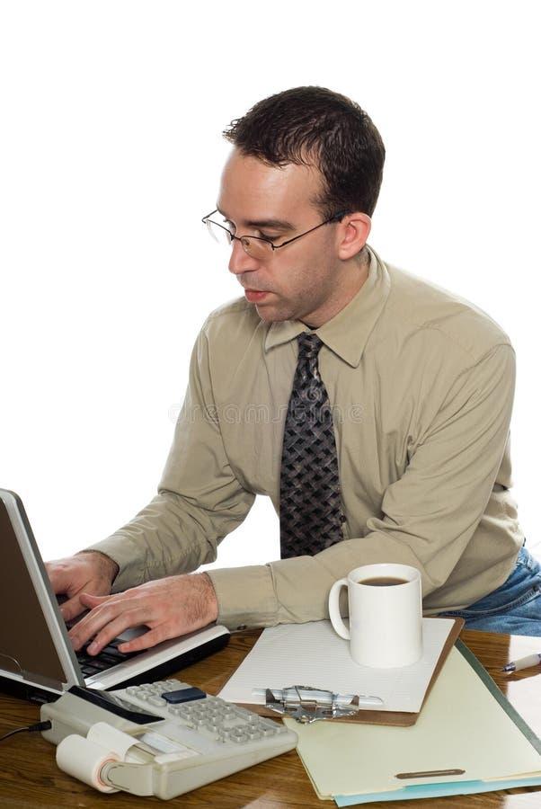 办公室键入的工作者 库存照片