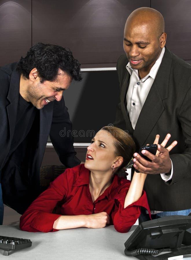 办公室骚扰 图库摄影