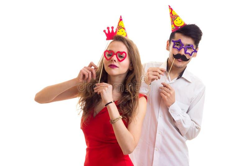 年轻加上卡片棍子和庆祝帽子 免版税图库摄影