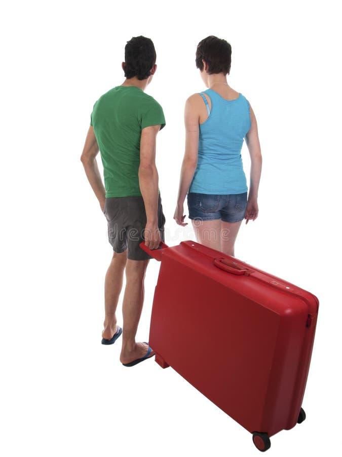 年轻加上在度假的手提箱 免版税图库摄影