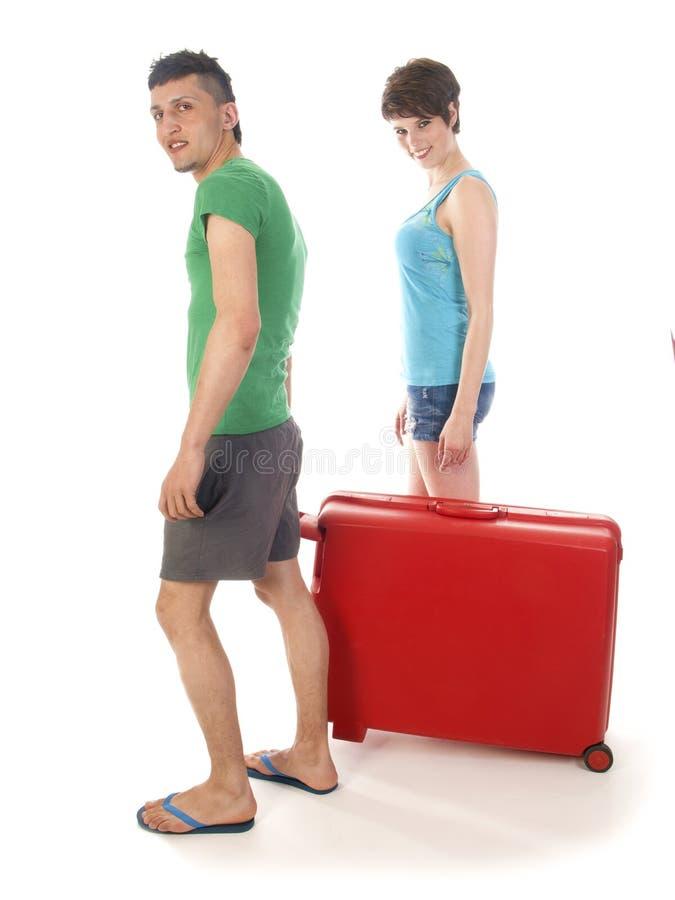年轻加上在度假的手提箱 库存图片