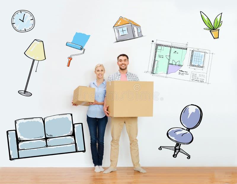 加上搬到新的家的纸板箱 图库摄影