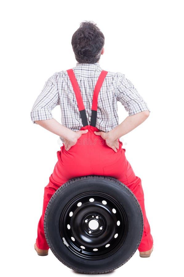 更加低后或腰部区域痛苦技工痛苦  免版税库存图片
