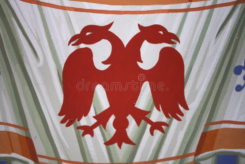 加倍朝向的老鹰、共同的标志在纹章和旗帜学 库存照片