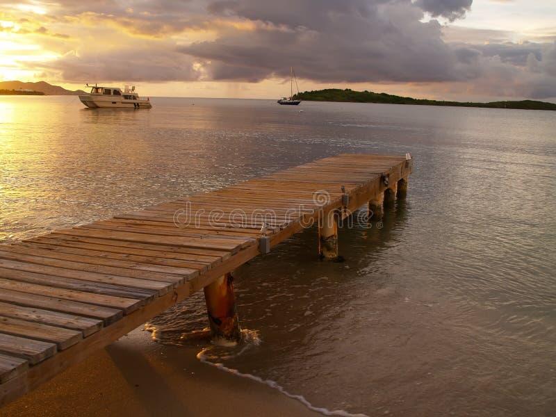 加勒比码头日落 库存照片