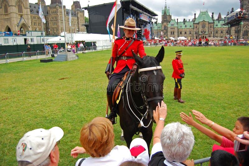 加拿大日RCMP骑乘马在渥太华,加拿大 免版税库存照片